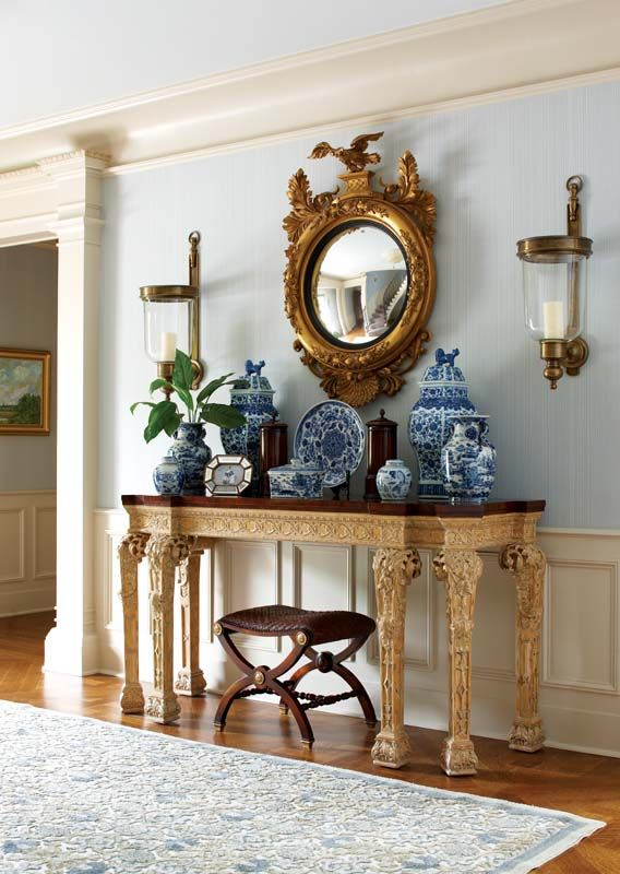 great entry...love the blue ginger jars and plates with the grand gold mirror