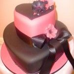 Pink and black wedding cake. Love the heart shape!