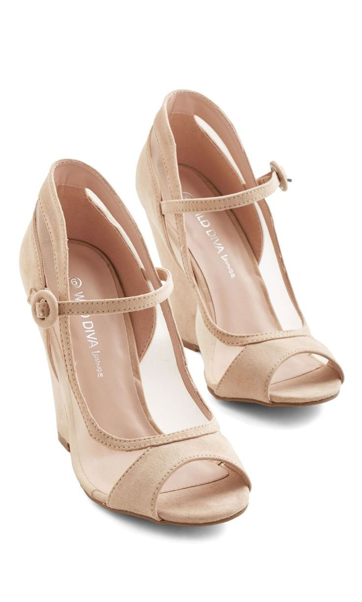 A different way of viewing the modern day nude open toed wedge heel.