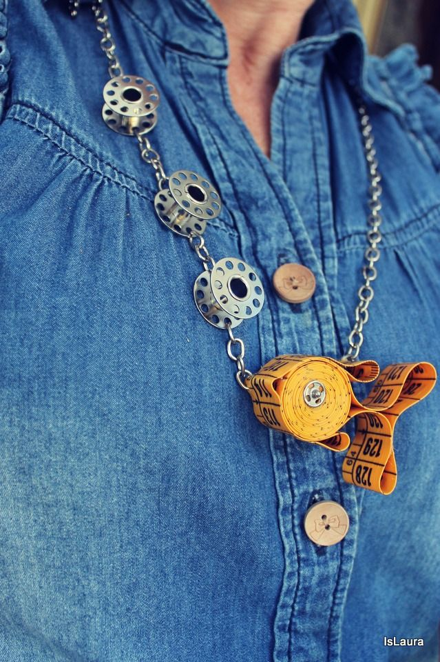 Fish with Bubbles Necklace made from a Measuring Tape, bobbins + a snap for the eye. :) The tutorial is available! #sewing #upcycling