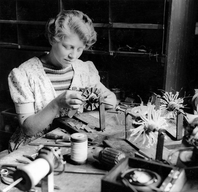 An Australian young woman armature winding in a munitions factory in South Australia in 1943. Photographer: Smith, D. Darian}