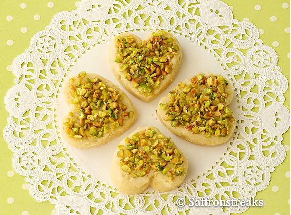 Orange infused Indian milk fudge or mawa barfi encrusted with chopped pistachios - an easy Indian sweet