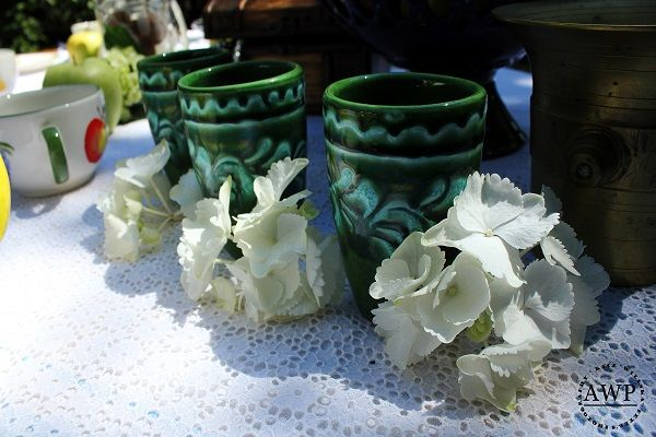 green ceramic glasses with white hydrangeas