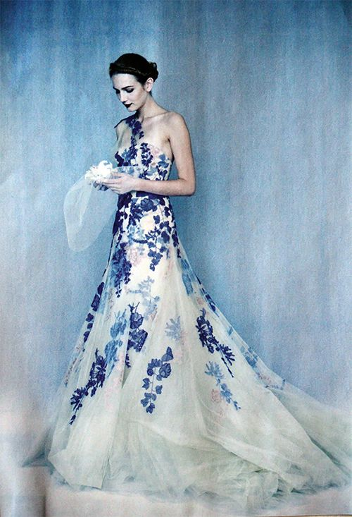 #bridalgowns - A gorgeous blue colored wedding dress with one shoulder neckline. This blue lace a-line gown bellows with layers of organza fabric. This ball gown could be used for a formal occasion or as a brides wedding dress. As custom dress makers here in the US we can recreate this style for you however you want and in any size. We specialize in replicas and affordable custom wedding dresses. https://www.dariuscordell.com/featured/custom-wedding-dresses-custom-bridal-gowns/