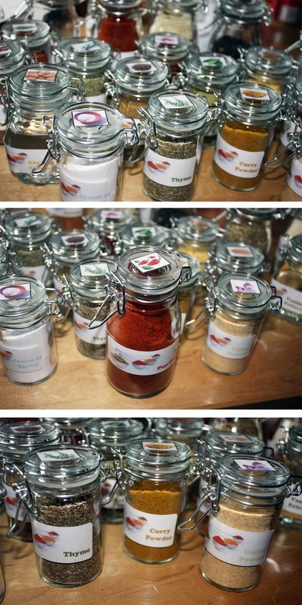I got a bunch of jars, filled them with spices and printed labels. I laminated the labels, too. Now I have cute, uniform spice jars in my cabinet.