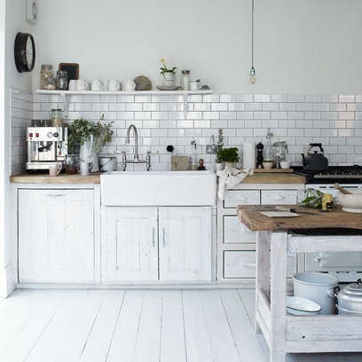 Love the white cabinets, butcher block, floors, subway tile, everything