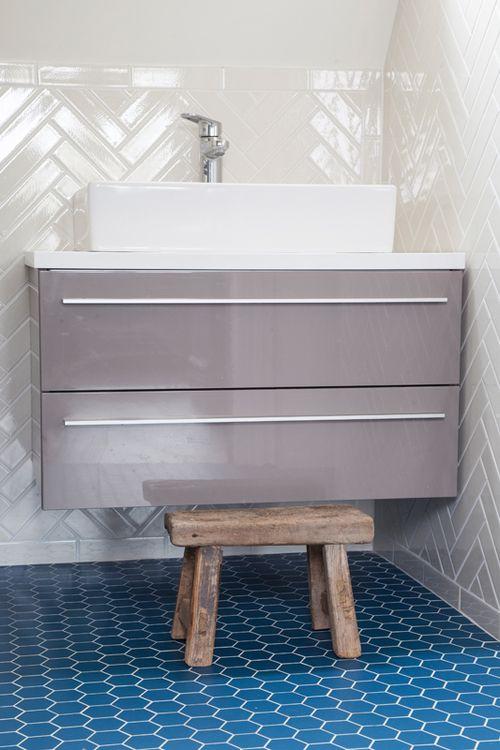 Herringbone white metro tiles, blue hexagonal floor tiles in kids' bathroom