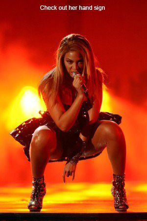 "BEYONCE, ever-so-subtly giving it up to ""El Diablo"" (the devil's horns)"