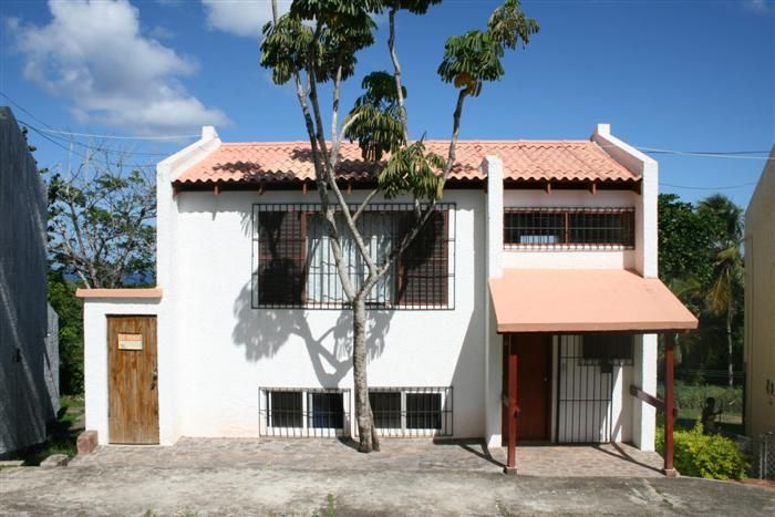 Listing #: V-12093 LG City: Sosua Price: U$62,900 Bedrooms: 2 Bathrooms: 2 Apartments: 1 Living area (sq. Feet): 1915.98 / sq Meters: 178       SPACIOUS TOWN HOUSE FOR SALE IN SOSUA   Never has there been a more affor1dable investment opportunity than this townhouse in Sosua. This fully furnished property in the Sosua's hills has two bedrooms, two bathrooms . Upon entering the house the first thing you will discover is the living room has comfortable furniture and comes with a  TV and a…