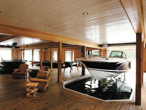 What, this old thing? Oh it's just my super cool basement/boat dock/lounging area... why where do you park your boats? lol So want this one day.