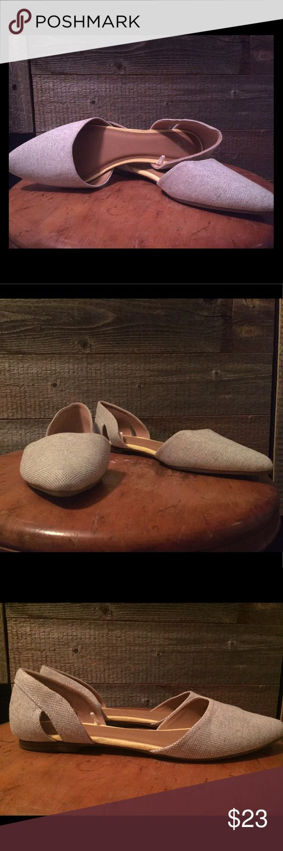 Gap fabric flats Size 8 Gap brand flats.  Fabric on the outside is grey/off white tint, yellow lining on the inside and brown leather type insole.  Never worn, no tags.  Last picture shows a slight mark on the left heel, both heels have the slight mark. GAP Shoes Flats & Loafers