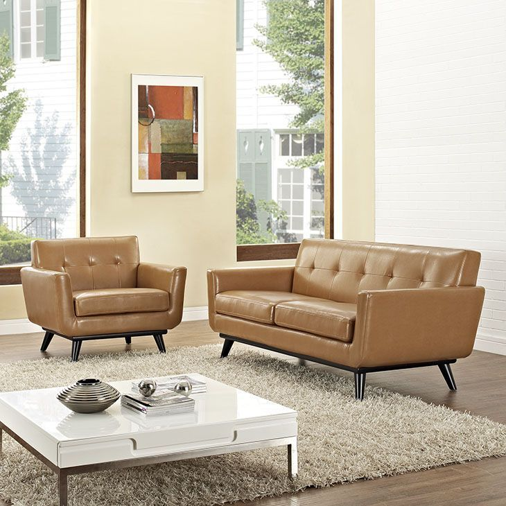Engage 2 Piece Leather Living Room Set, Tan - 0 Set Includes: One - Engage Leather Armchair with wood Legs One - Engage Leather Loveseat with wood Legs. Material: Bonded Leather, leg and frame is rubber wood. Weight: 150. Assembly Required