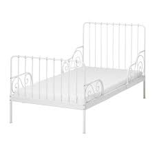 2 twin white IKEA wrought iron bed frames. Both are in great condition - wood slats and mattresses are included. These are adjustable in 3 sizes.... first bed - toddler bed - full twin.