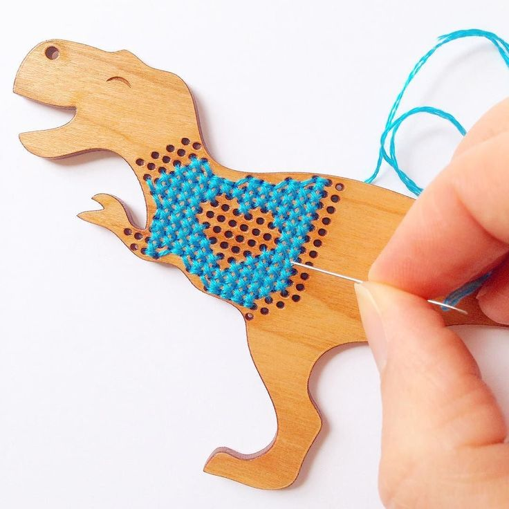 "Prototyping sweater patterns for this little guy.  Who would be excited about a DIY kit for a ""t. rex in a sweater"" cross stitch necklace?  I've made two of these already and they are so quick & easy to stitch up! by ohplesiosaur I just pre-ordered a Glowforge 3D printer and cutter at 40% off. Get $100 off your order with this link http://ift.tt/1RZRHPk"