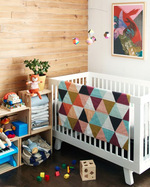 Love the quilt and the wood wall.