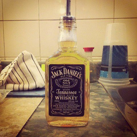 Instead of a boring dish soap bottle on the counter.... fill an alcohol bottle (Long Live JD) add a liquor spout and voila.