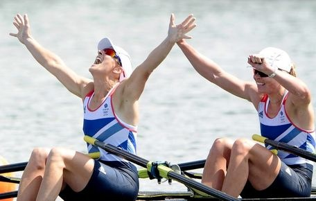 Katherine Grainger and Anna Watkins of Great Britain celebrate after winning gold in the Women's Double Sculls