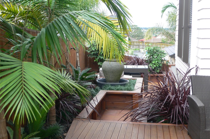 Long, narrow sloping site. Designed and planted by Fusion Landscape Design.