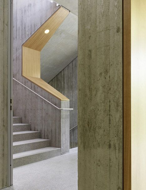 The grain in the timber is complimented by the texture of the off form concrete | Mörike Gymnasium by Klumpp and Klumpp Architekten.