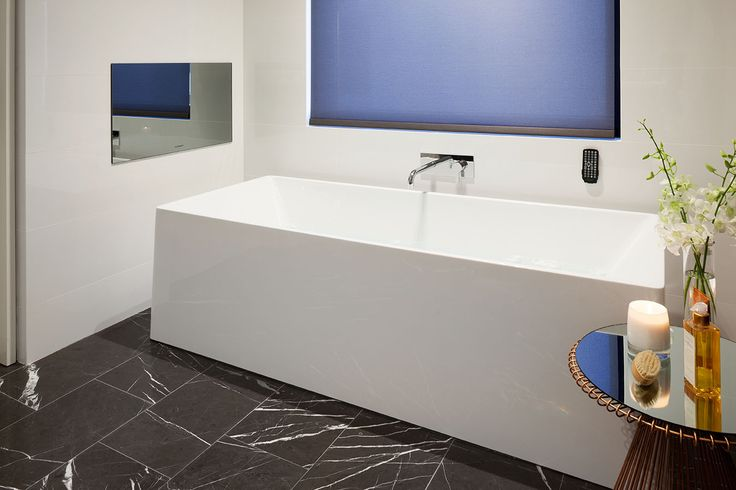 Soaking in a freestanding bath with your own entertainment wall-mounted and all controlled at the touch of a button.  Sheer bliss!  Designed and built by Urbane Projects, Perth.