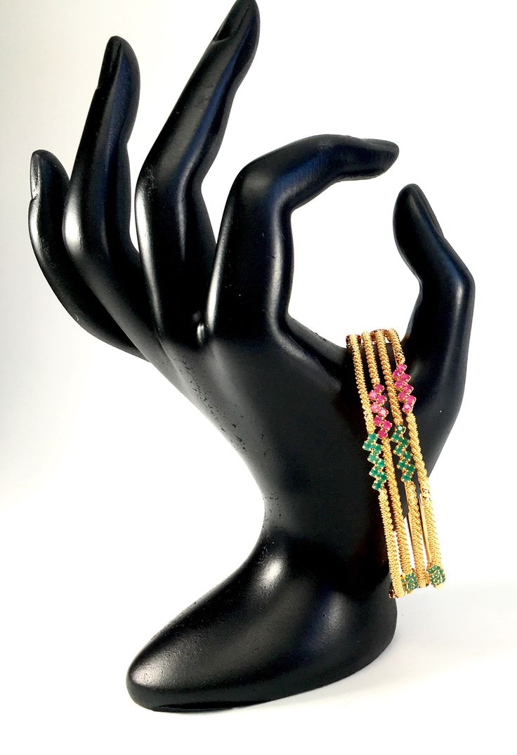 thin gold bangles with ruby and emerald stones