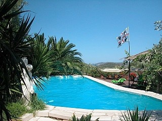 £1700, large garden, private pool, hot tub, near beaches and watersports - but on the east coast south of Olbia.  Sardinian country house, location on its own, big olive grove, sea view, pool Holiday Rental in Porto San Paolo from @HomeAwayUK #holiday #rental #travel #homeaway