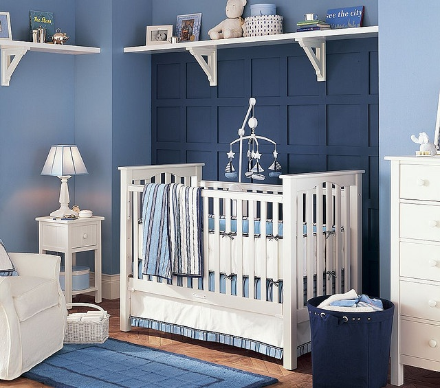Try blue on blue with white furniture for a contemporary nautical theme. High shelves provide attractive storage without taking up floor space.