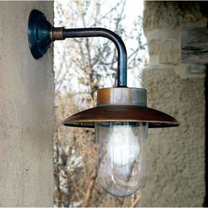 This expertly aged copper and brass wall light has a rustic character that is sure to add timeless charm to any outdoor area! By employing a technique of rapid oxidization to gain this effect, the light has not only been enhanced aesthetically but also further protected from exterior forces, especially saline spray.