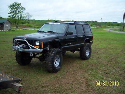"""Custom Winch Bumper for 1984-2001 XJ Jeep Cherokee. 3/16"""" thick steel construction, except for the mounting brackets, which are 1/4"""" thick. Fully Welded Mounting uses stock holes and also picks up the"""
