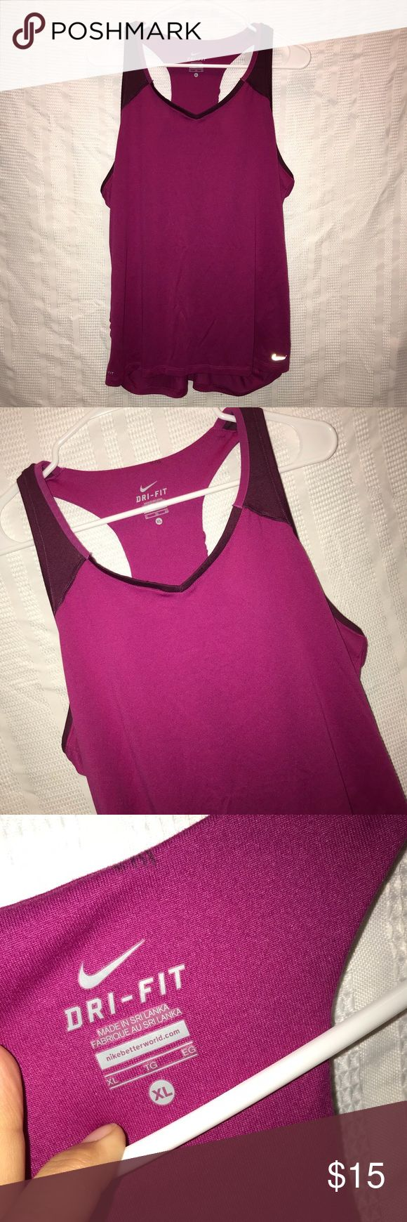 "Nike Dri Fit athletic workout tank top size XL Awesome athletic tank top that has a magenta color and is made from polyester. The top is perfect for working out, running, walking or being at the gym. It had been worn before and is still in excellent condition. The chest measurement is 42"", the shirt length is 27.5"" Nike Tops Tank Tops"