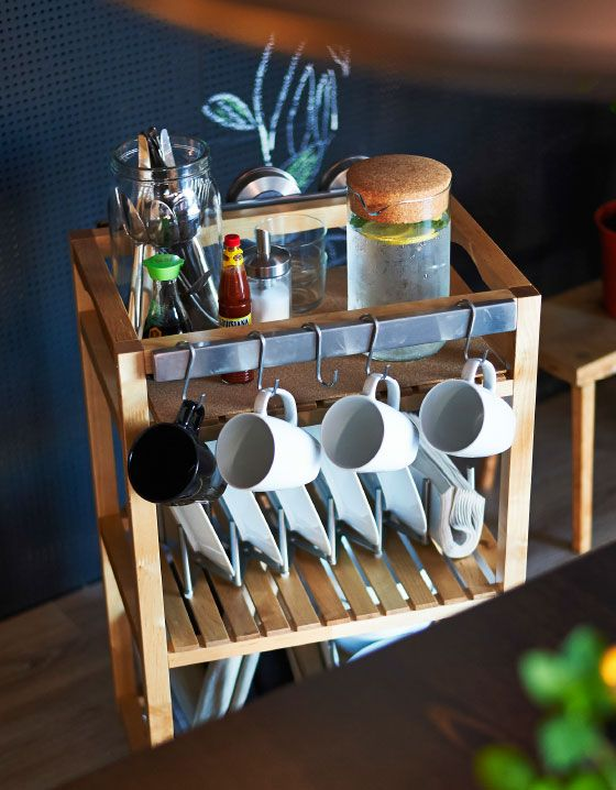 Add some hooks, a magnetic knife strip and some plate sorting organizers and you can transform a plain bathroom cart into the perfect dining table server.