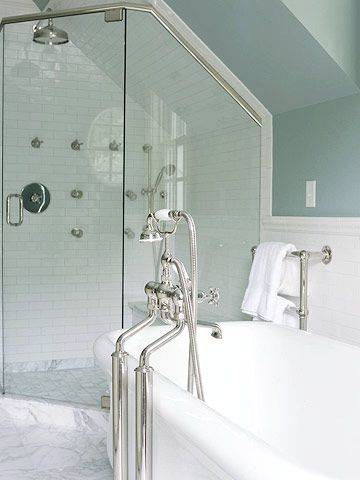 Create Your Own Shower  Standard-size showers aren't your only options. Create your own shower -- which can be as simple as glass doors, tile walls, and plumbing fixtures -- to match the contours of your eaves. The clear glass of this corner shower gives the illusion of more space, whereas an opaque enclosure would have removed part of the room from view, shrinking the space visually.