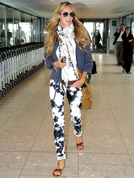 Elle Macpherson in Isabel Marant (almost from head to toe). Buy the belt and shoes at www.shopmrsh.com/products/Isabel%5FMarant/Merry%5FSandal/