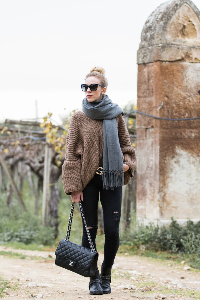 Casual Travel Outfit: oversized sweater, gray scarf, Gucci belt, black jeans, Frye moto boots, Chanel Jumbo classic flap bag, how to layer for casual travel outfit