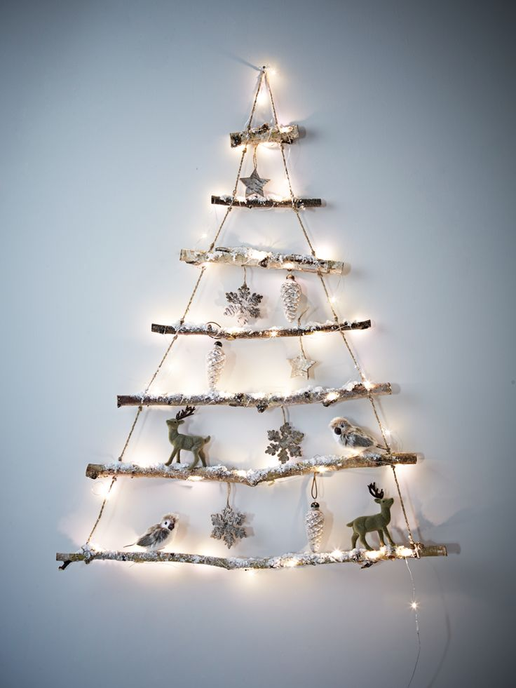 Alternative Christmas tree. Perfect for those who love Christmas but are short on space, our small rustic hanging tree has been carefully created using seven natural birch branches hung together with strong jute string.