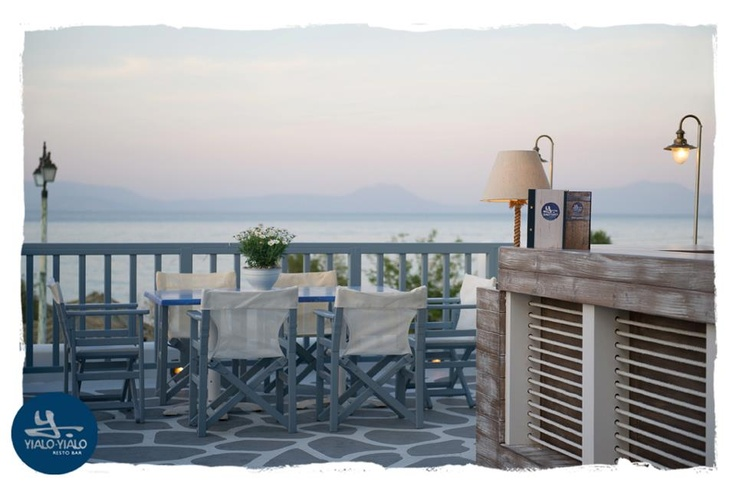 At roof: an informal, outdoor open bar setting with panoramic view of the Corinthian Gulf. © Vicky Lafazani