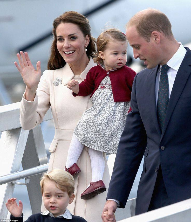 George stepped from a people carrier and began waving with one hand and then frantically with both to the amusement of William who smiled as Kate held Charlotte