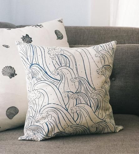 A comfy and colorful accent for your living space, this canvas pillow cover is printed with a hand-illustrated design. Cotton and linen blend canvas is screenprinted with a repeating pattern of cresting waves in dark blue ink.
