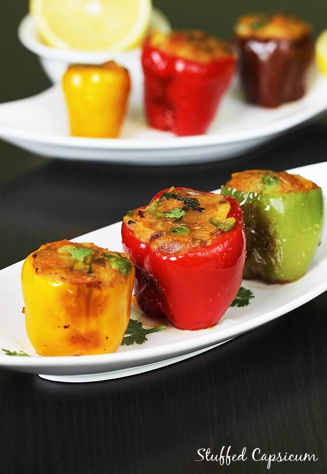 stuffed capsicum recipe - delicious spiced potato stuffed bell peppers with step by step photos. Makes a wonderful snack or a side in any meal.