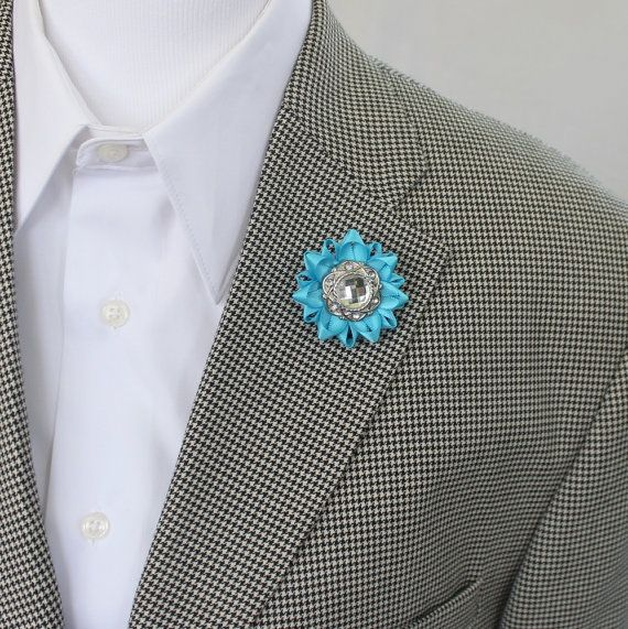 Choose your color for this lapel flower! Each flower is hand-sewn with a fancy crystal center. The width is 1 3/4 with an easy to use clutch pin