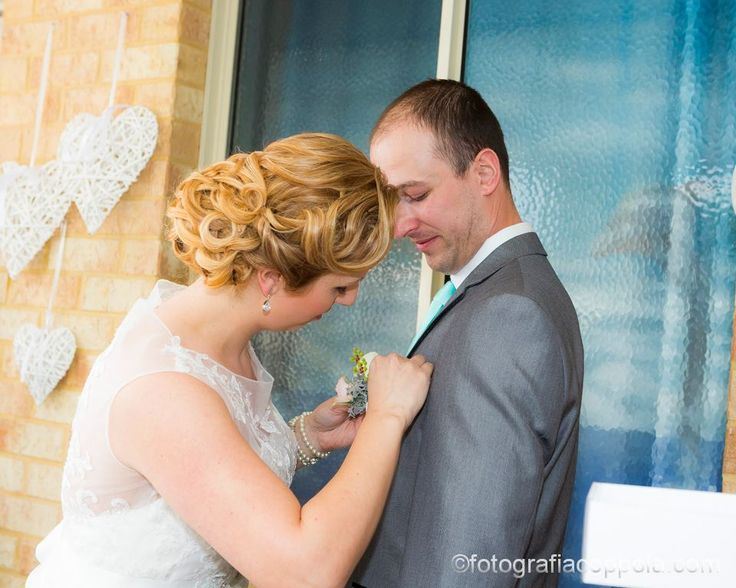 Romantic curls and waves in a low bun by Total Brides hair & makeup