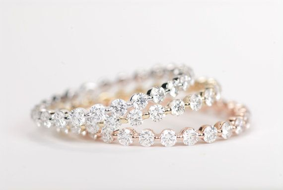 These are pretty and I like the daintiness o them- Diamond Wedding Band 14K Yellow Gold by SundariGems on Etsy