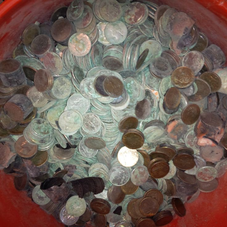 This was a large batch of quarters corroded by salt water sent to us in 5 gallon buckets.  Rocks, sand, and pieces of metal were mixed with the shipment, and that's ok.  We accept coins in any condition.  You don't need to sort them by denomination or prepare them in any way.  Just send non-bankable, unsorted, mixed, wet, dirty, rusty, corroded, old coins to us as-is.  We will take care of the rest. --- http://coin-cleaning-service.merschat.com