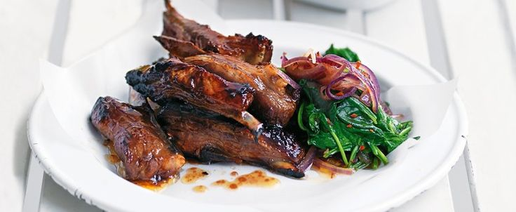 Sticky Lamb Ribs with Jacket Potatoes and Spicy Spinach recipe, brought to you by MiNDFOOD.