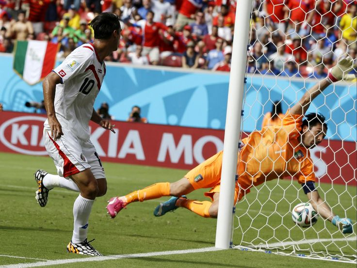 Costa Rica's Bryan Ruiz (10) watches as the ball goes past Italy's goalkeeper Gianluigi Buffon to score his side's first goal during the group D World Cup soccer match between Italy and Costa Rica at the Arena Pernambuco in Recife, Brazil, Friday, June 20, 2014