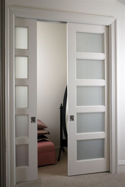 TSL5000 pocket doors in MDF with White Lami glass inserts - link to find a dealer