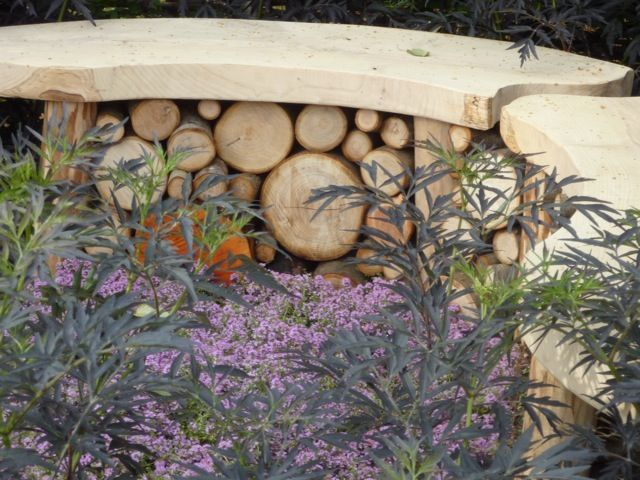 In the 'It's Only Natural' wildlife garden  a curved wooden bench doubled up as a log habitat for insects. If you are handy you could make it yourself.