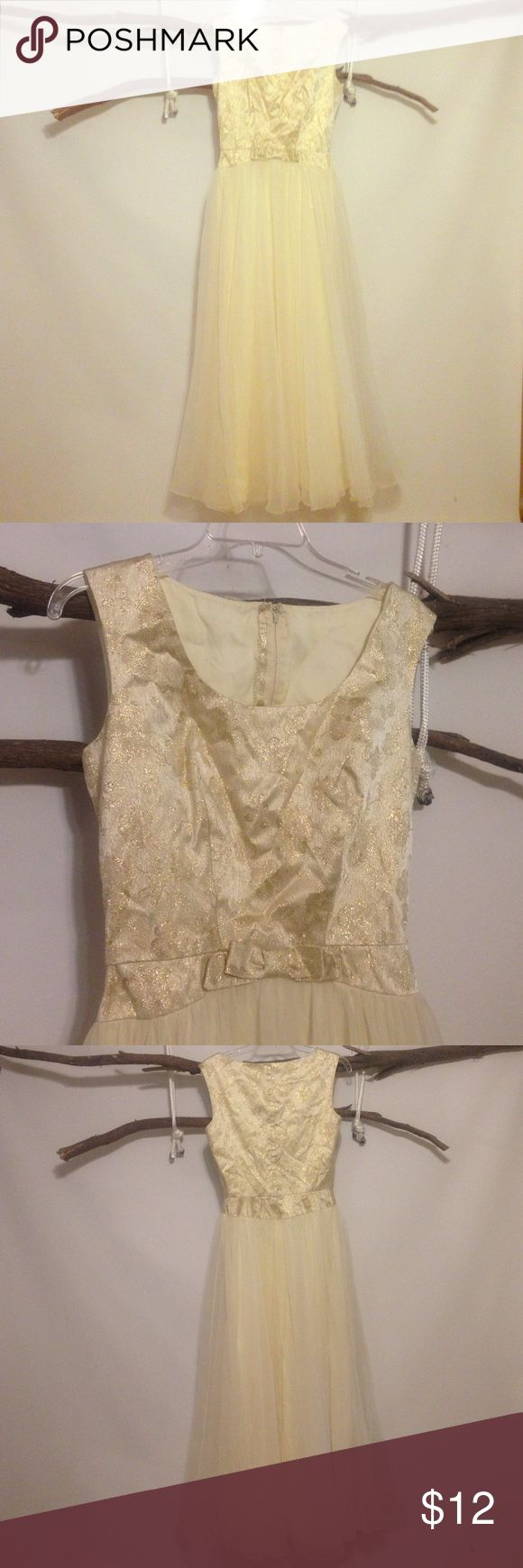 """Gold and Cream Formal Lined. Back zipper. Bust 34"""". Waist 26"""". Although this is marked as a 12 - runs small. Length 55"""". Dry clean only mike benet formals Dresses Prom"""