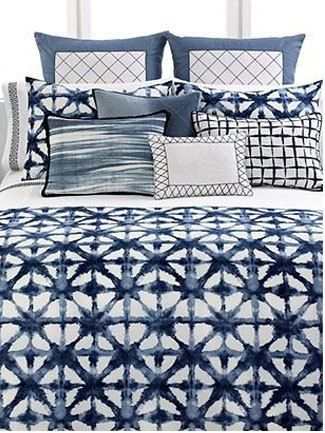 Mix blue and white patterns in your bedroom for a stylish look