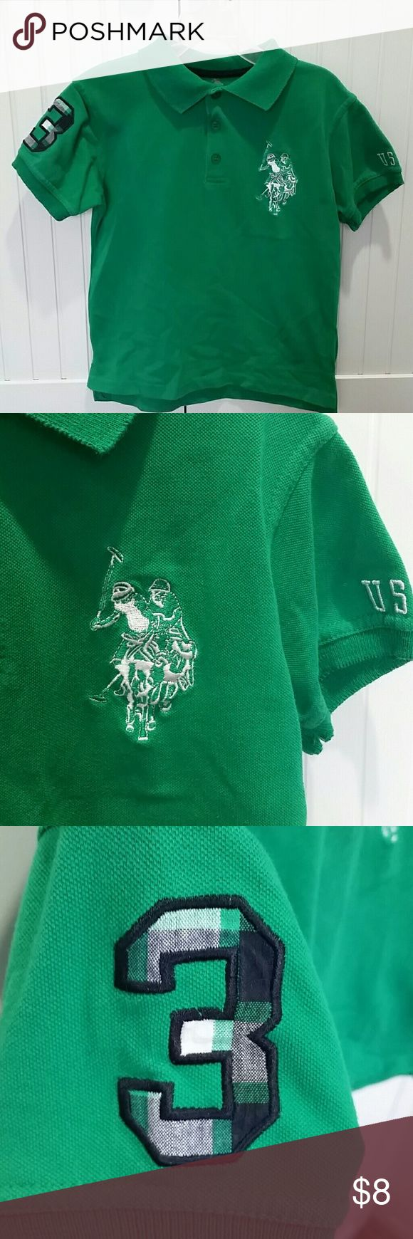 Boys 5/6 Green Polo Shirt This green boys polo shirt by U. S. Polo Association has quite a lot of detail! It is size 5/6.   This Polo features 2 stitched Polo Riders on the front of the shirt as well as USPA and a green plaid number 3 on the sleeves. There are 3 green usable buttons on the front.  The back of the top features the U.S. Polo Assn. logo with the number 90 in front of polo sticks, as well as a smaller print of the 2 Polo players that are seen on the front of the shirt.  The…